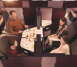 The unique Qsuite business class. Four seats are arranged together, which can be kept separate, or with the simple slide of panels, two, three or all four of the suites can be converted into an open area for a family or other traveling group to dine together. Double beds can also be deployed