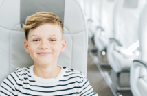 a child flying alone on an airBaltic plane