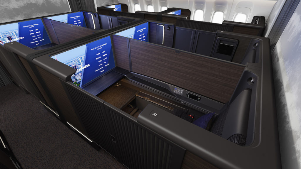The central dividers in the first class suites can be lowered to create a shared space