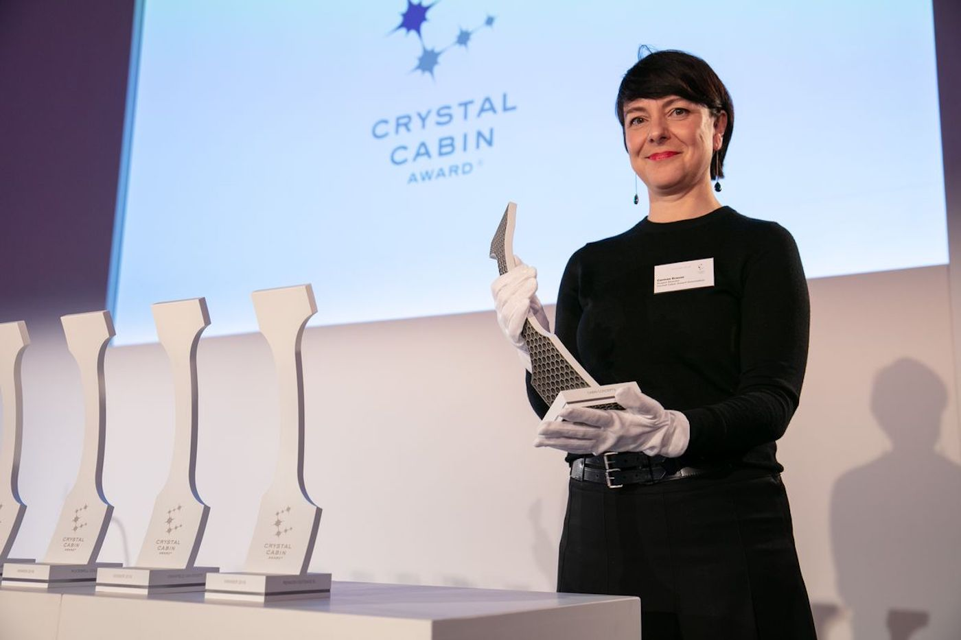 Carmen Krause is project director of the Crystal Cabin Awards holding a trophy