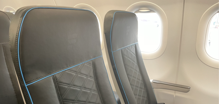 a frontier economy class seat with a padded finish