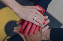 several womens hands together in unity