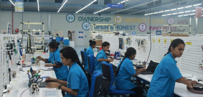 workers assembling wiring systems in the pune india factory