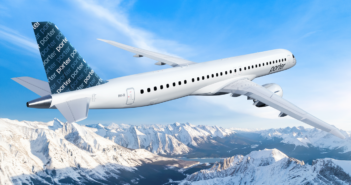 a porter airlines E195-E2 plane flying over mountains