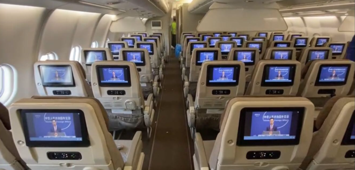 seatback entertainment screens in a china airlines plane, showing live news programmes