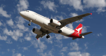 A QantasLink Airbus A320 plane flying in the sky