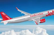 A jet2.com A321neo plane flying across a blue sky